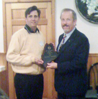 Dick Lambert receiving the first annual Code Enforcement Officer of the Year award from the MBOIA President